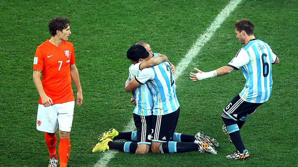 Netherlands and Argentina players react after their World Cup semi-final shootout