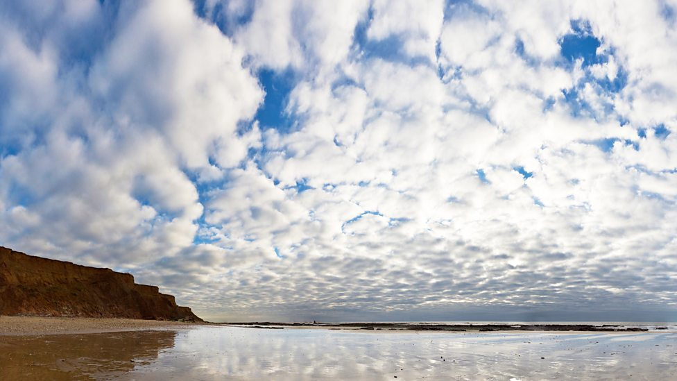 Altocumulus clouds over Compton Bay on Isle of Wight. Image by Getty Images/ Jason Swain.