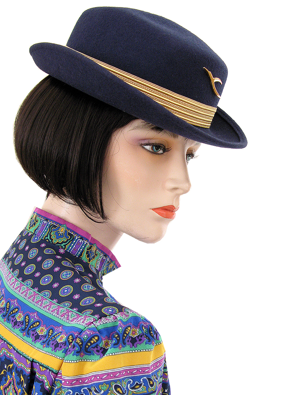 """One of my favourite uniforms: I love the colour combination of the blouse and the hat."" (Kuwait Airways, late 1990s)"
