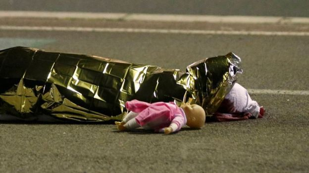 This image of a doll next to a body has already become symbolic of the attack