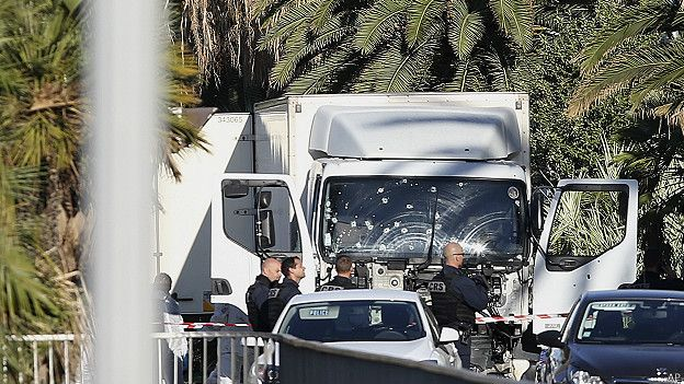 Police inspect the truck in the daylight