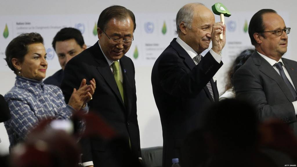 Laurent Fabius holding a green gavel