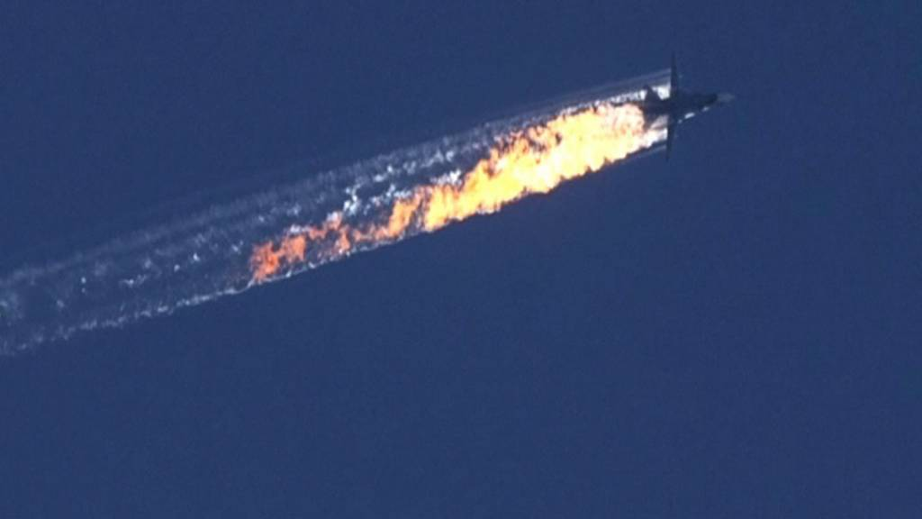 A burning trail is shown as a plane comes down after being shot down near the Turkish-Syrian border