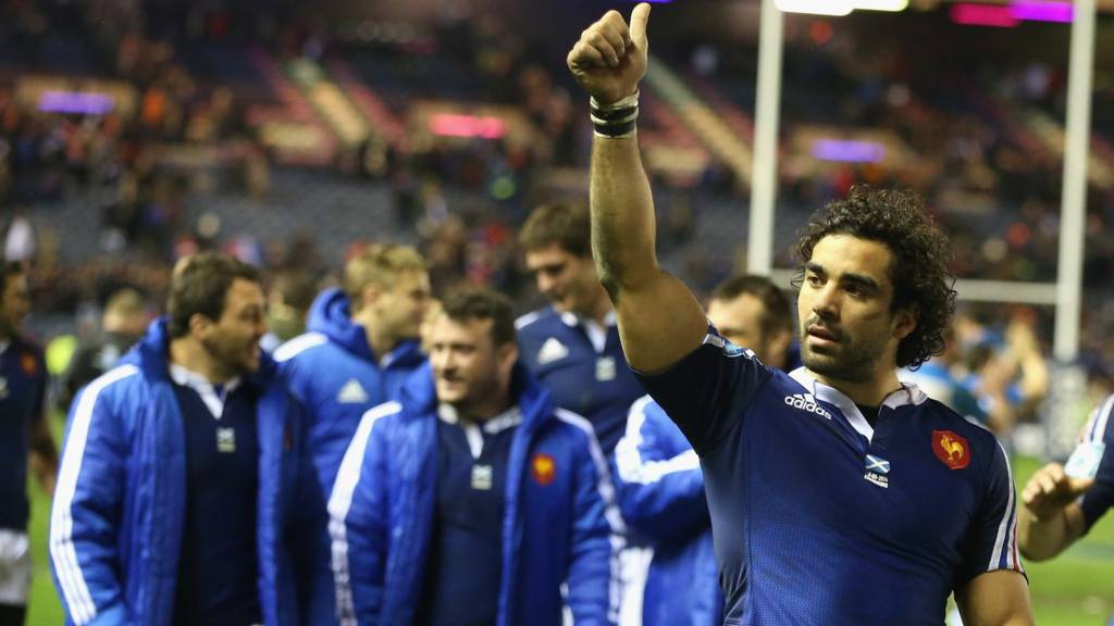 Yoann Huget celebrates a Six Nations victory against Scotland