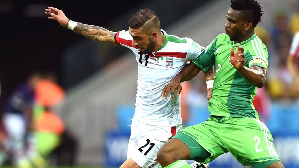 Joseph Yobo of Nigeria challenges Ashkan Dejagah of Iran