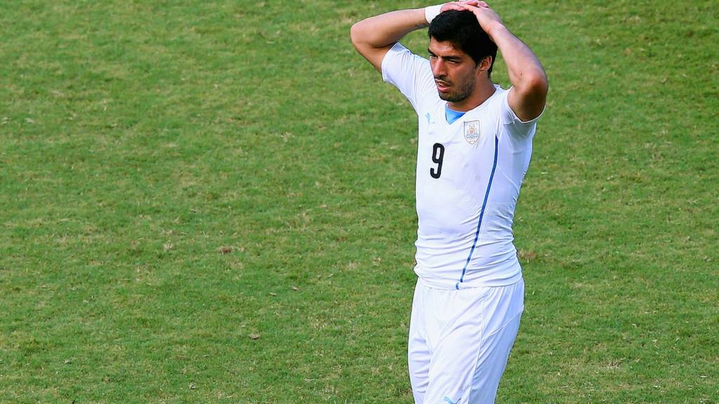 Luis Suarez of Uruguay reacts during the 2014 Fifa World Cup Brazil Group D match between Italy and Uruguay