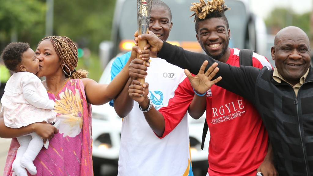 baton bearer with supporters