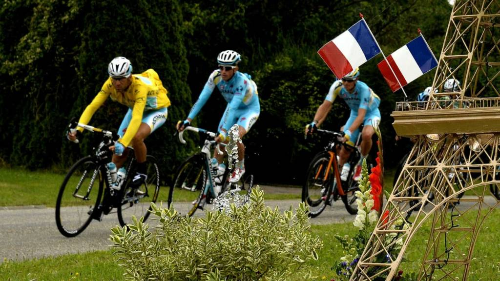 Vincenzo Nibali rides past a model of the Eiffel Tower
