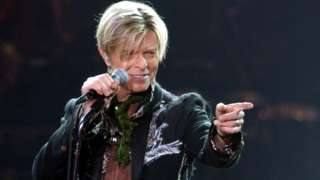 A file photograph showing British rock legend David Bowie perfoming on stage during his concert in Hamburg, Germany, 16 October 2003