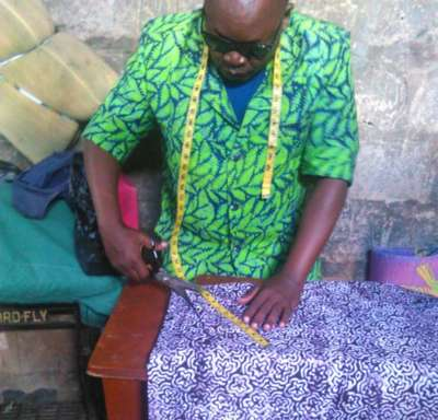 Abdallah Nyangalio making a shirt