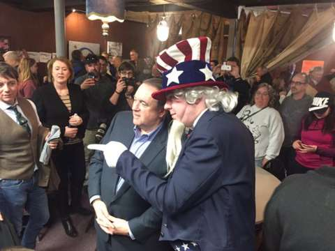 American democracy in action. @GovMikeHuckabee poses with a man dressed like Uncle Sam