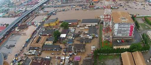 Buildings and shops in rising flood waters