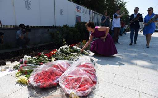 People lay flowers at the scene of the attack in Nice