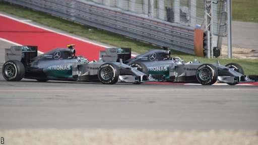 Mercedes driver Lewis Hamilton overtakes Nico Rosberg