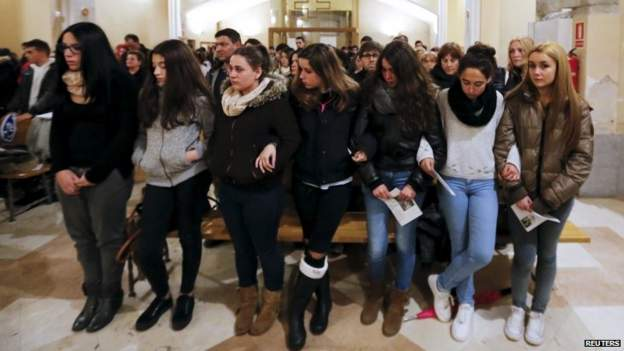 Students attend a mass in Llinars del Valles, the town where German exchange student victims of the Germanwings plane crash attended school