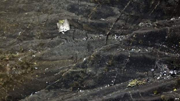 Debris lies on the mountain slopes after the crash of the Germanwings plane over the French Alps
