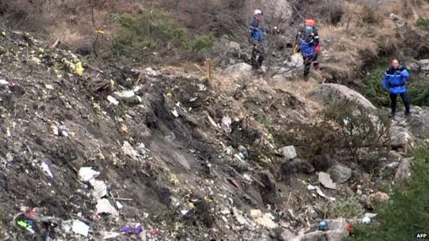 A screen grab taken from AFP video shows search and rescue personnel at the Germanwings crash site in the French Alps