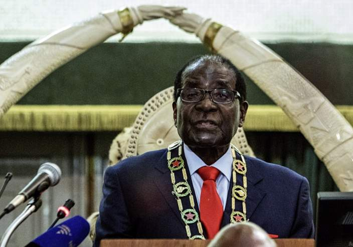 Zimbabwe's President Robert Mugabe delivers his State of the Nation address in Parliament in Harare on August 25, 2015.