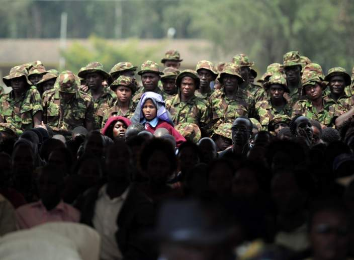 "Family and comrades of slain Kenya Defence Forces (KDF) soldiers wait to be addressed by Kenya""s President Uhuru Kenyatta, Somalia""s Hassan Sheikh Mohamoud and Nigeria""s Muhamadu Buhari who arrived to pay their respects at a memorial, on January 27, 2016"