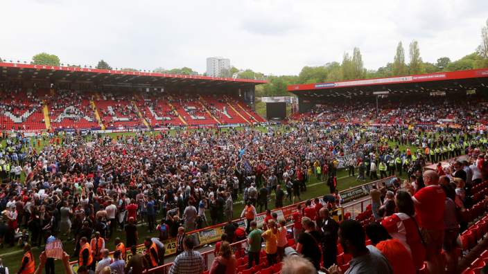 Charlton fans protest on the pitch after the Sky Bet Championship match between Charlton Athletic and Burnley on May 7, 2016