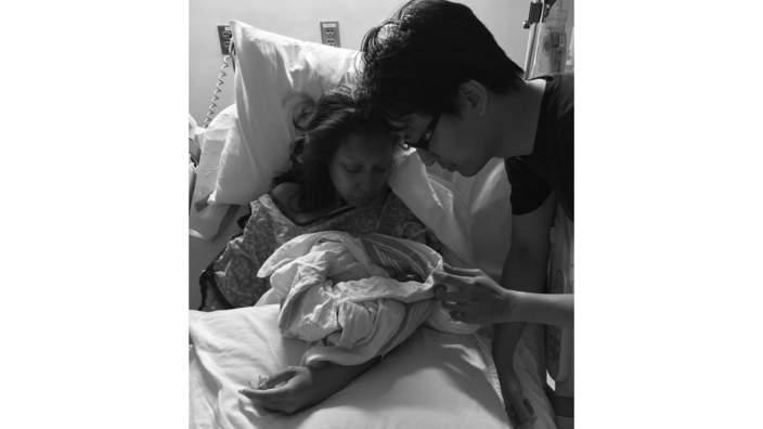 Wendy cradling her baby