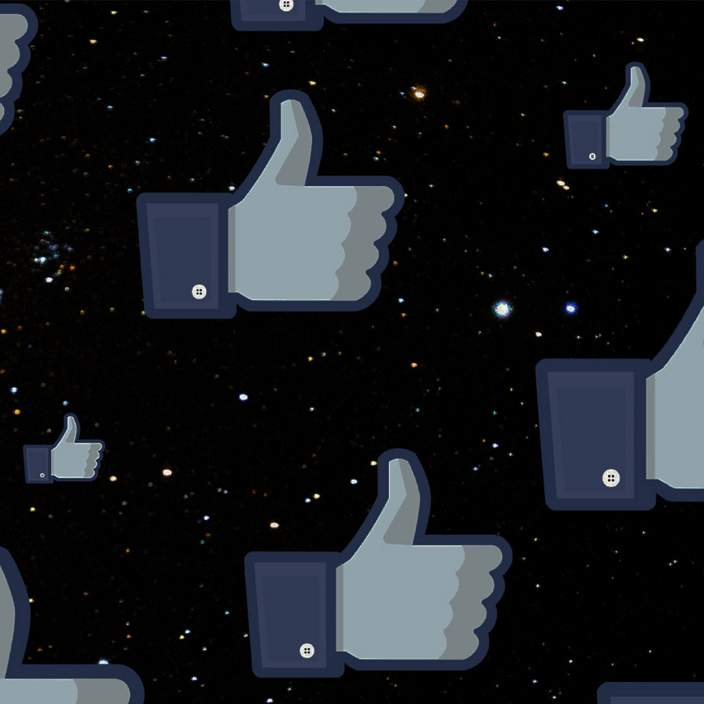 Facebook thumbs on space background