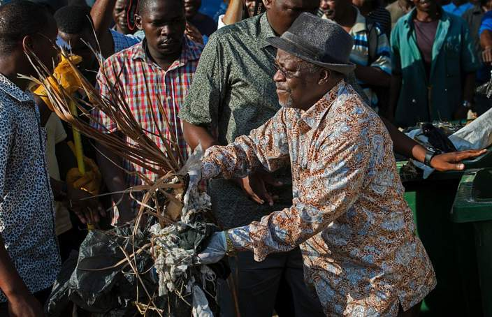 Tanzanian President John Magufuli joins a clean-up event outside the State House in Dar es Salaam on December 9, 2015