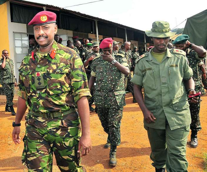 his photo taken on August 27, 2012, shows Brigadier Muhoozi Kainerugaba (L), new commander of the Ugandan Special Forces Command, at the Sera Kasenyi training centre for Special Forces in Kampala on August 16, 2012