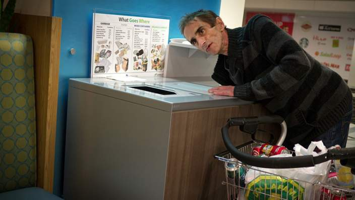 Aaron Goodman's photo of Johnny collecting cans