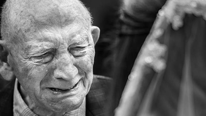 Old man crying at bride