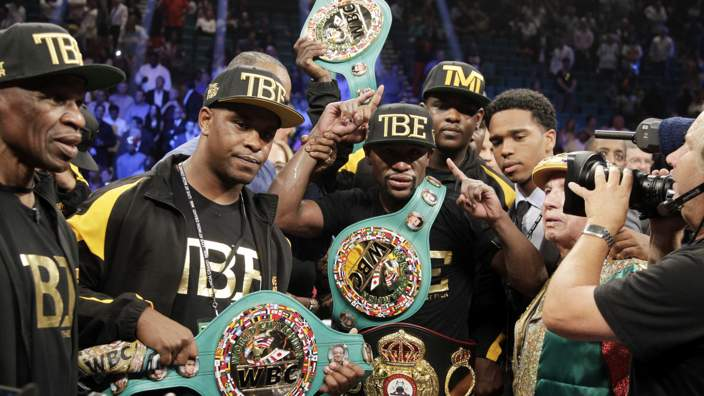 Floyd Mayweather with belts