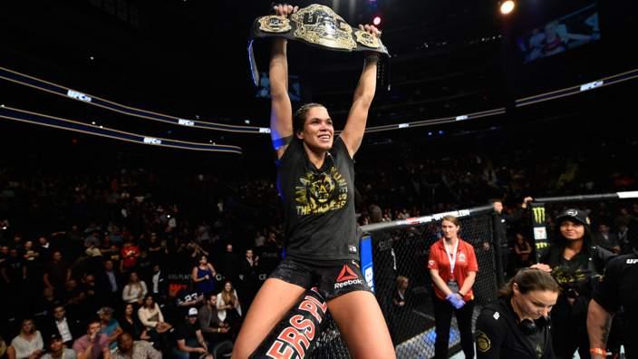 Amanda Nunes celebrates her UFC 215 victory