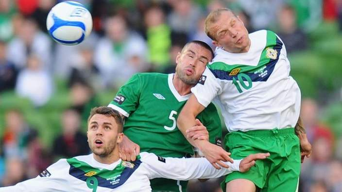 Damien Delaney is sandwiched between Josh McQuoid (left) and Warren Feeney (right) in a match between Republic of Ireland and Northern Ireland in 2011