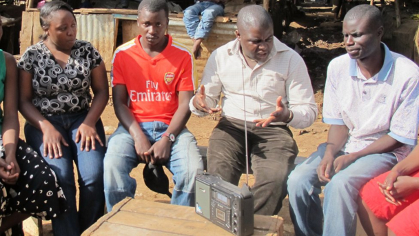 Radio listeners gather in Nairobi's Kibera slum