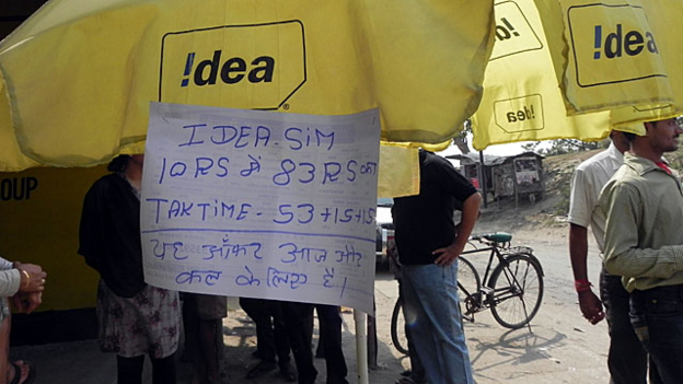 A dealer of pre-paid mobile SIM cards advertises the latest offer