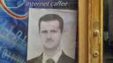 A picture of President Assad in a Syrian cafe.