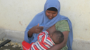 A woman breastfeeding her baby in Somalia.