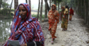 Climate Asia - women walking down a road.