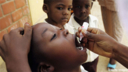 A child is given a polio vaccine, Nigeria. © Getty Pictures