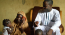 Yahaya Abdul-Rahman and his wife Salamatu listen to a BBC Media Action show in Nigeria.