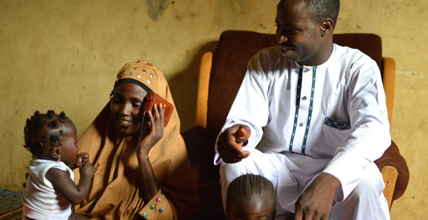 A Nigerian family listen to the radio.
