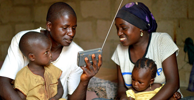 A family in Kaduna, northern Nigeria listen to a radio.