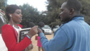 A ZNBC producer interviews a college student for Zambia sexual health show Tikambe Matulande.