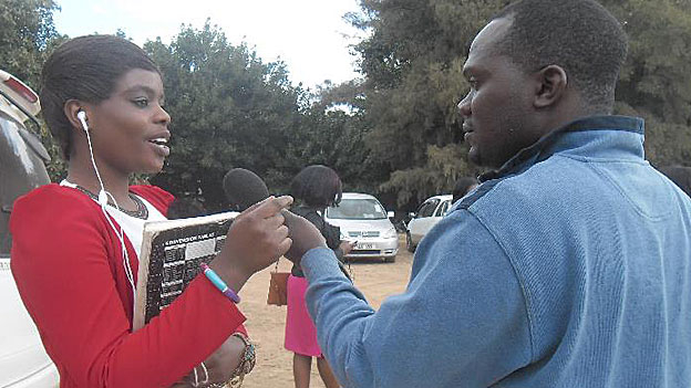 A ZNBC producer interviews a college student for Zambia sexual health show.