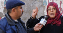 A woman is interviewed in Tunisia