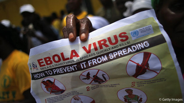 A woman holds a paper about Ebola in Liberia. (Getty Images)