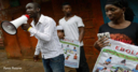 Volunteers give out information about Ebola in Sierra Leone