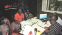 Presenter Olabisi Olu-Garrick and collegues on air