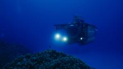 Submersible with lights on in the deep ocean