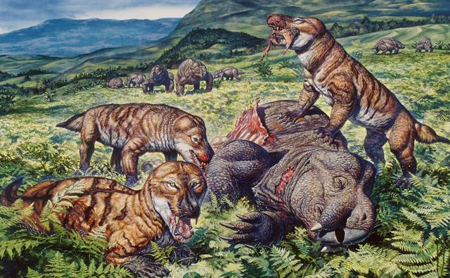 A group of mammal-like reptiles eating a dicynodont therapsid